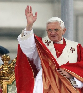 Pope Benedict XVI waves before starting an open air mass in Warsaw